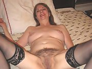 Mature woman plays with hairy pussy with dildo in stockings
