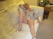 Mature blonde wife shows off her pussy on the couch