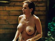 Photos of busty MILF wife showing her multiple pussy piercings