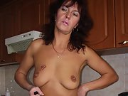 Brunette babe in black lingerie fingers her asshole and her pussy