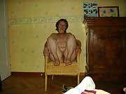 Mature wife spreads her legs