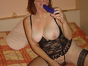 Horny wife shows off her big tits as she poses in her sexy lingerie