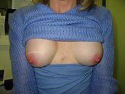 Milf shows her perky tits and pretty pink nipples
