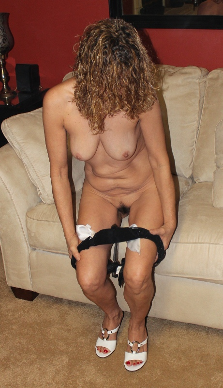 Housewife striptease for boy