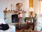 Luscious blonde gets naughty and strips in her living room