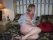 Blonde mature wife showcases her large tits and shaved pussy