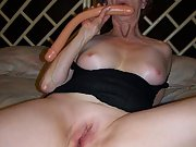 Mature wife shows off her shaved pussy while she masturbates