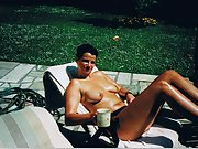 Brunette wife tans in the sun outside naked