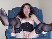 Showing stockings and spread legs reveal shaved pussy