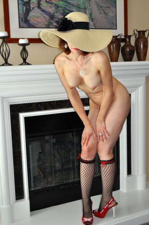 Adjusting her pantyhose