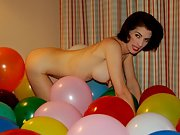 Its her birthday and shes playfully nude in balloons