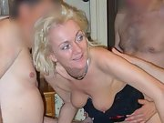 Two sexy babes get fucked and suck in group sex party