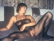 Yvonne in basque bodystocking and boots with legs open