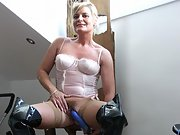 Smiley mature blonde slut shows her bushy cunt in lingerie