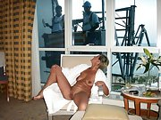 Russian slutty wife poses semi-nude next to the windows for the view