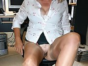 Office after hours in Stockings spreading legs to show cunt