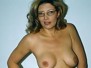 Mature blonde milf loves to strip and show her body