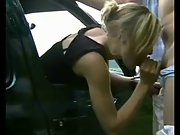 Blonde hot momma gives a sensual blowjob from the front car seat
