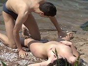 Horny voyeur catches a lusty couple having hot sex on the beach
