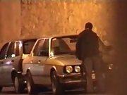 Voyeur catches a horny couple having sex on the car outdoor