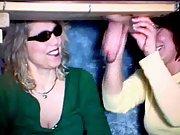 Mature blonde whore and redhead slut milking stiff cock at gloryhole