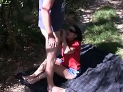 Mature milf enjoys in giving her man head in the nature on picnic