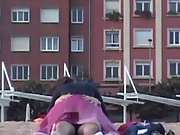 Young and lusty couple get caught on the beach having sex in public