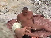 Mature dude plays with his hard cannon on the nude beach