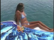 Tanned slut with steaming hot body gives her minge to the boat owner