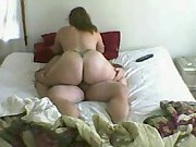 Chubby momma with low back tattoo rides hard rod on bed