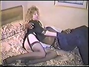 Cheating blonde wife in slutty lingerie takes on black cock on bed