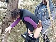Pale brunette milf gets stiff black sausage doggy style in woods