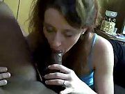 Randy brunette wife enjoyus sucking hard black cock in living room