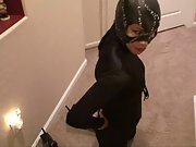 Dark haired asain beauty dressed up like cat woman teases in pov