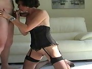 Dirty amateur milf gives head in the living room wearing lingerie